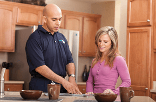 Man and Woman standing in a Kitchen